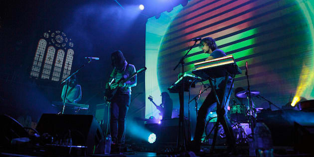 MANCHESTER, UNITED KINGDOM - JULY 12: Dominic Simper, Kevin Parker, Jay Watson and Julien Barbagallo of Tame Impala perform on stage at Albert Hall on July 12, 2014 in Manchester, United Kingdom. (Photo by Andrew Benge/Redferns via Getty Images)