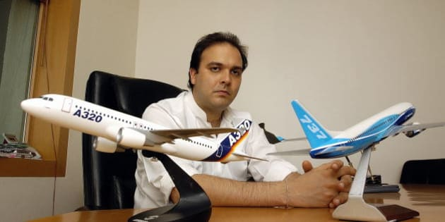 INDIA - AUGUST 03:  Jeh Wadia, Managing Director GoAir, the low-cost carrier promoted by the Wadias of Bombay Dyeing, poses with Models of Aircraft / Airbus A320 and 737, at office, in Mumbai, India. Potrait, Sitting  (Photo by Soumik Kar/The India Today Group/Getty Images)