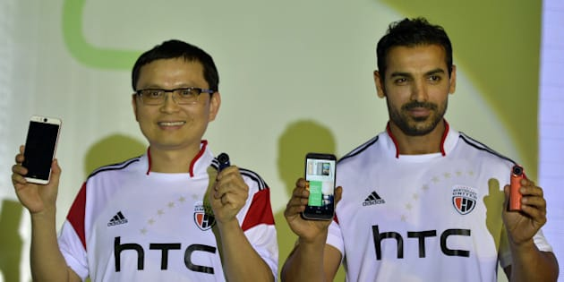 MUMBAI, INDIA  OCTOBER 17: John Abraham at the launch of new HTC cell phone in Mumbai.(Photo by Milind Shelte/India Today Group/Getty Images