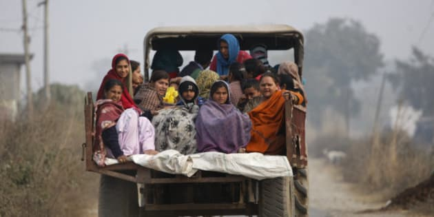 Indian villagers sit in the back of a vehicle as they flee their homes fearing firing from the Pakistan side of the border at Bainglad village in Samba sector, about 52 Kilometers from Jammu, India, Saturday, Jan. 3, 2015. Pakistani and Indian border guards traded artillery fire along the disputed border region of Kashmir, killing two people and wounding eight, officials said Saturday. Both Pakistan and India blamed each other for starting the fire that began Friday night. In India, police officer Rajesh Kumar said Pakistani shelling in the Kathua sector killed a woman and wounded seven villagers. (AP Photo/Channi Anand)