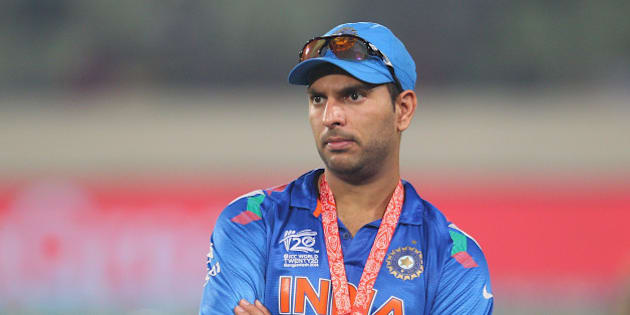 DHAKA, BANGLADESH - APRIL 06:  Yuvraj Singh of India looks on during the presentations after the Final of the ICC World Twenty20 Bangladesh 2014 between India and Sri Lanka at Sher-e-Bangla Mirpur Stadium on April 4, 2014 in Dhaka, Bangladesh.  (Photo by Scott Barbour/Getty Images)