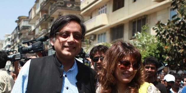 MUMBAI, INDIA - APRIL 2: (File photo) Indian politician Shashi Tharoor with his wife Sunanda Pushkar Tharoor outside Wankhede Stadium, while entering  to watch  ICC cricket World  cup Final  match between India and Srilanka on April 2, 2011 in Mumbai, India. Sunanda Pushkar, the 52-year-old industrialist wife of Union HRD minister Shashi Tharoor was found dead on Friday at a seven-star hotel where the couple had checked in together a day earlier, the police said. News of her death emerged late in the evening, coming within two days of her Twitter spat with a Pakistani journalist, Mehr Tarar, over an alleged affair with the minister. Pushkar, who has business interests in Dubai and was the Congress minister's third wife, was found dead in the bedroom of The Leela Palace suite number 345 around 8.15pm. Mehr Tarar, a columnist with Pakistan's Daily Times, reacted to the news of Pushkar's death in two consecutive tweets: What the hell. Sunanda. Oh my God and I just woke up and read this. Im absolutely shocked. This is too awful for words. So tragic I dont know what to say. Rest in peace, Sunanda. (Photo by Hemant Padalkar/Hindustan Times via Getty Images)