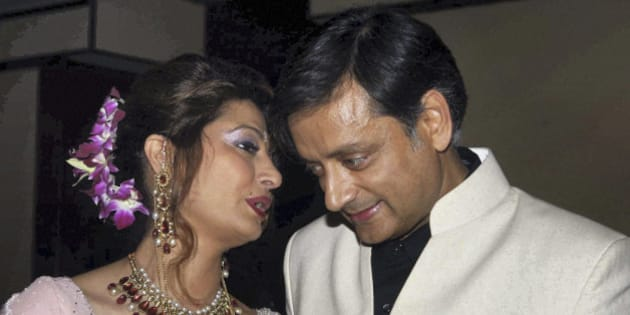 Former Indian Junior Foreign Minister Shashi Tharoor listens to his wife Sunanda Pushkar at their wedding reception in New Delhi, India, Saturday, Sept. 4, 2010. Tharoor resigned from his post earlier this year amid allegations of corruption in the bidding for an Indian premier league team at auction in April that also involved his friend and businesswoman Pushkar. (AP Photo)