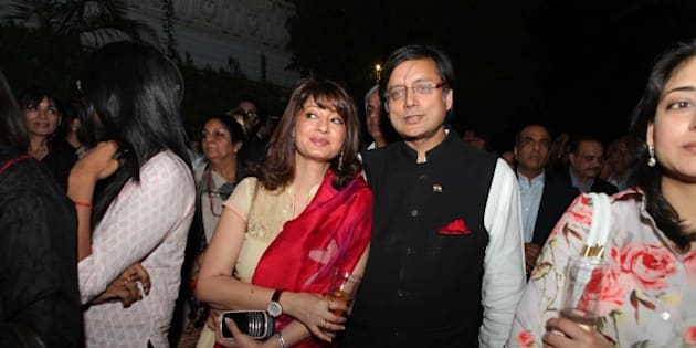 NEW DELHI, INDIA - APRIL 30 : Congress MP Shashi Tharoor with his wife Sunanda Pushkar Tharoor attend the book launch of writer columnist Aashti Bhartia's first book 'Vote of Confidence' at Olive Beach, Hotel Diplomat on April 30, 2012 in New Delhi, India. The book talks about the young Indian Politicians being the future of the country. ( Photo by Manoj Verma/ Hindustan Times via Getty Images)