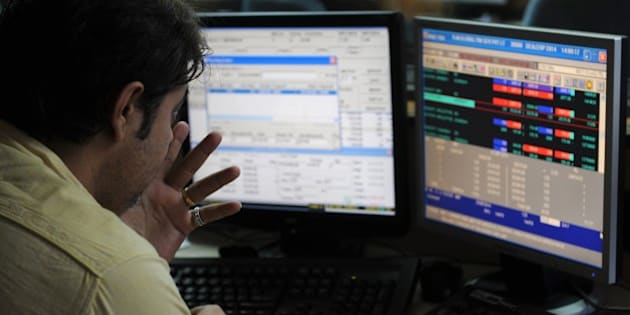 An Indian stockbroker watches his screen during intra-day trading at a brokerage house in Mumbai on September 1, 2014. The benchmark 30 share BSE index Sensex rose 262.19 points to hit new lifetime high of 26,900.30.  AFP PHOTO / INDRANIL MUKHERJEE        (Photo credit should read INDRANIL MUKHERJEE/AFP/Getty Images)