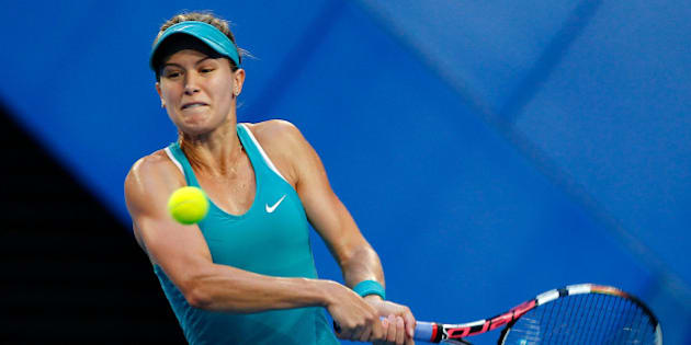 PERTH, AUSTRALIA - JANUARY 06:  Eugenie Bouchard of Canada plays a backhand to Serena Williams of the United States in the women's singles match during day three of the Hopman Cup at Perth Arena on January 6, 2015 in Perth, Australia.  (Photo by Will Russell/Getty Images)