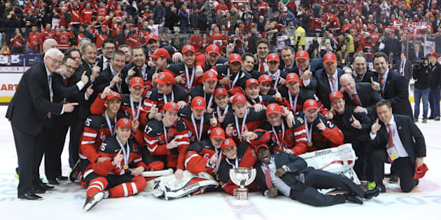 TORONTO, ON - JANUARY 5:  Team Canada poses for a team photo after defeating Team Russia in the Gold medal game in the 2015 IIHF World Junior Hockey Championship at the Air Canada Centre on January 5, 2015 in Toronto, Ontario, Canada. Team Canada defeated Team Russia 5-4 to win the Gold medal. (Photo by Claus Andersen/Getty Images)