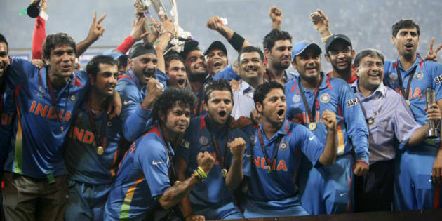 MUMBAI, INDIA - APRIL 02:  Indian cricketers pose with the trophy after victory in the Cricket World Cup 2011 final over Sri Lanka at The Wankhede Stadium in Mumbai on April 2, 2011. India beat Sri Lanka by six wickets. (Photo by Naveen Jora/India Today Group/Getty Images)