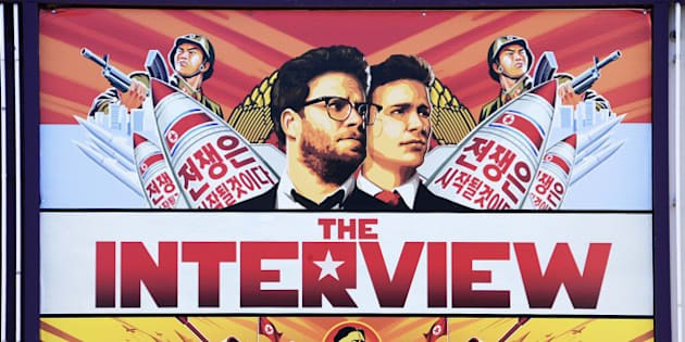 A poster for 'The Interview'  is displayed on the marquee of the Los Feliz 3 cinema December 25, 2014 in Los Angeles, California. Some two hundred US theaters are screening the Sony Pictures film starting Christmas Day, notwithstanding threats of terrorism and murmurings of an international cyberwar spawned by the farcical comedy about a plot to assassinate the leader of North Korea before it was even released.   AFP PHOTO / ROBYN BECK        (Photo credit should read ROBYN BECK/AFP/Getty Images)