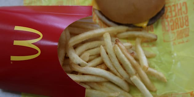 NOVATO, CA - DECEMBER 08:  In this photo illustration, a McDonald's cheeseburger and fries are displayed on a table at a McDonald's restaurant on December 8, 2014 in Novato, California.  McDonald's reported a worse than expected decline in November global same-restaurant sales. (Photo Illustration by Justin Sullivan/Getty Images)