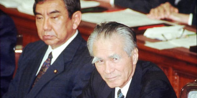 Japanese Prime Minister Tomiichi Murayama jots down notes as he awaits the result of no-confidance vote at the Lower House plenary session in Tokyo Tuesday, June 13 1995.  Murayama received the embarrassment by the opposition's non-confidence motion on the ave of his departure for the G7 summit but the motion was rejected.  At left is Foraign Minister Yohei Kono. (AP Photo)