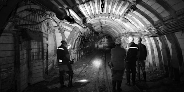 BLACK AND WHITE VERSION Miners visit a gallery at the Trudovskaya mine in Donetsk's Petrovskiy district, eastern Ukraine, controlled by pro-Russia rebels, on December 8, 2014. The mine was flooded and the coal production stopped after the electricity was cut due to the shellings. AFP PHOTO / ERIC FEFERBERG        (Photo credit should read ERIC FEFERBERG/AFP/Getty Images)