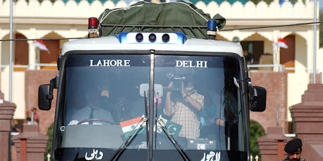 Indian Border Security Force officer Ish Aul, guides bus driver Aamir Khan, to the customs office after the Lahore-Delhi bus entered India at the Joint Border Post at Wagah, India, Friday, July 11, 2003. The bus service between the India and Pakistan resumed Friday after it was disrupted 18 months ago by threats of war between the hostile, nuclear-armed neighbors. (AP Photo/Aman Sharma)