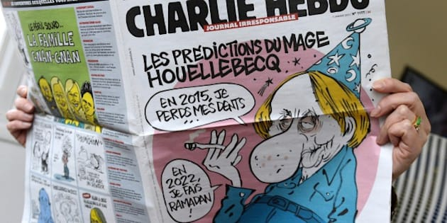 A person reads the latest issue of the French satirical newspaper Charlie Hebdo in Paris on January 7, 2015, after gunmen armed with Kalashnikovs and a rocket-launcher opened fire in the offices of the weekly in Paris, killing at least 11. AFP PHOTO / BERTRAND GUAY        (Photo credit should read BERTRAND GUAY/AFP/Getty Images)
