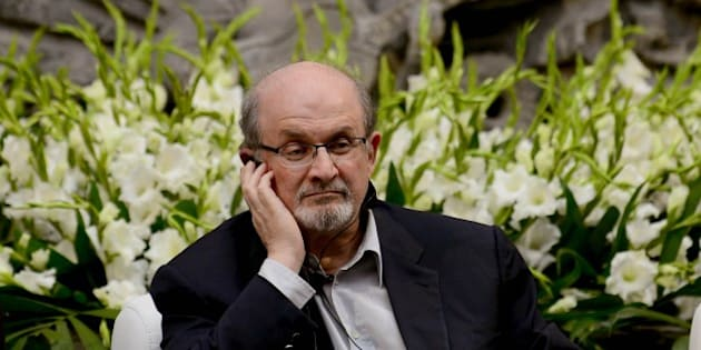 Indian born British writer Salman Rushdie smiles during a talk for the XV anniversary of the 'Casa Refugio Citlatepetl'  at the Museo de la Ciudad in Mexico City, on October 5, 2014. Rushdie is in a two-day visit. AFP PHOTO/ALFREDO ESTRELLA        (Photo credit should read ALFREDO ESTRELLA/AFP/Getty Images)