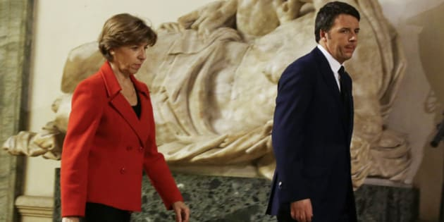 "Italian Premier Matteo Renzi, right, walks with French Ambassador Catherine Colonna during his visit at the French Embassy to express his condolences for the Paris newspaper attack  in Rome, Wednesday, Jan. 7, 2015. Masked gunmen shouting ""Allahu akbar!"" stormed the Paris offices of a satirical newspaper Wednesday, killing at least 12 people, including the paper's editor, before escaping in a getaway car. (AP Photo/Gregorio Borgia)"