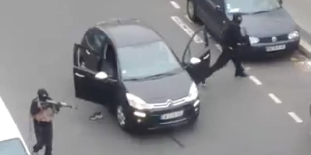 "A police officer pleads for mercy on the pavement before being shot in the head by masked gunmen during an attack on the headquarters of the French satirical newspaper Charlie Hebdo in Paris, France, on January 7, 2015. Gunmen have attacked the Paris office of French satirical magazine Charlie Hebdo, killing 12 people and injuring seven, French officials say. At least two masked attackers opened fire with assault rifles in the office and exchanged shots with police in the street outside before escaping by car. President Francois Hollande said there was no doubt it had been a terrorist attack ""of exceptional barbarity"". A major police operation is under way in the Paris area to catch the killers. Screen capture via ABACAPRESS.COM"
