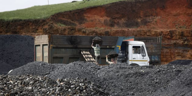 In this July 1, 2013 photo, Indian laborers load coal into a truck at a roadside coal depot at Khliehriet in Meghalaya, India. For six years, India's monopoly coal producer has missed production targets that already fall short of the country's demand. Industry has been left scrambling for pricier imports. Power cuts are chronic, and hundreds of millions still have no access. But what looks like a looming power crisis could actually be a rising energy transformation, with the country poised for a shift toward solar to end chronic energy woes and offer first-time access to hundreds of millions nationwide. (AP Photo/Anupam Nath)