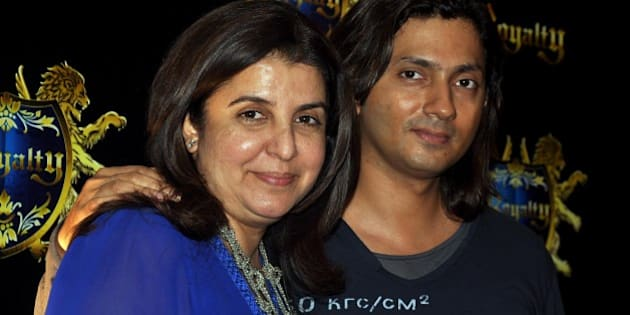 Indian Bollywood film director and choreographer Farah Khan with husband Shirish Kunder to attend the pre-wedding party of Indian Bollywood actors Ritesh Deshmukh and Genelia D'souza in Mumbai on January 24, 2012.  AFP PHOTO/STR (Photo credit should read STRDEL/AFP/Getty Images)