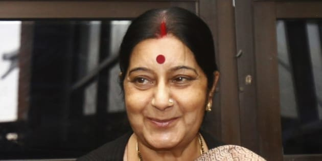 Indian Foreign Minister Sushma Swaraj greets journalists upon arrival at the airport in Katmandu, Nepal, Friday, July 25, 2014. Swaraj is on a three-day visit to the country during which she will focus on strengthening bilateral ties and is also expected to prepare the ground for Prime Minister Narendra Modi's visit to the country. (AP Photo/Niranjan Shrestha)