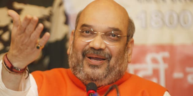 MUMBAI, INDIA - JANUARY 2: BJP leader Amit Shah interacts with the media during a press conference held at Gaware Club on January 2, 2015 in Mumbai, India. Shah is also likely to discuss the problems within the government with ministers engaging in the game of one-upmanship. (Photo by Anshuman Poyrekar/Hindustan Times via Getty Images)