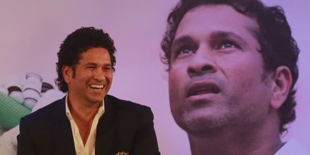 "Retired cricket great Sachin Tendulkar smiles after launching his autobiography,""Playing It My Way,"" in Mumbai, India, Wednesday, Nov.5, 2014.(AP Photo/Rafiq Maqbool)"