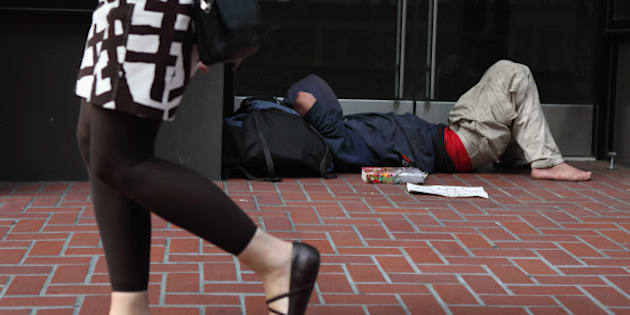 SAN FRANCISCO - SEPTEMBER 16:  A homeless man sleeps in the doorway of a closed store on September 16, 2010 in San Francisco, California. The U.S. poverty rate increased to a 14.3 percent in 2009, the highest level since 1994.  (Photo by Justin Sullivan/Getty Images)