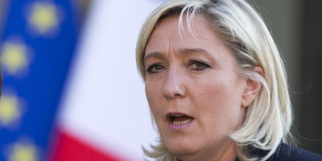 French far-right Front National party president Marine Le Pen talks to the media at the end of the meeting with French President Francois Hollande at the Elysee Palace, on Friday May 16, 2014 in Paris. (AP Photo/Jacques Brinon)