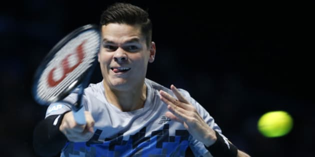 Canada's Milos Raonic plays a return to Switzerland's Roger Federer during their ATP World Tour Finals tennis match at the O2 Arena in London, Sunday, Nov. 9, 2014. (AP Photo/Alastair Grant)