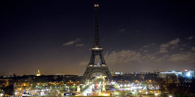 PARIS, FRANCE - JANUARY 08:  As a tribute for the victims of yesterday's terrorist attack the lights of the Eiffel Tower were turned off for five minutes at 8pm local time on January 8, 2015 in Paris, France. Twelve people were killed yesterday including two police officers as two gunmen opened fire at the offices of the French satirical publication Charlie Hebdo. on January 8, 2015 in Paris, France.  (Photo by Aurelien Meunier/Getty Images)