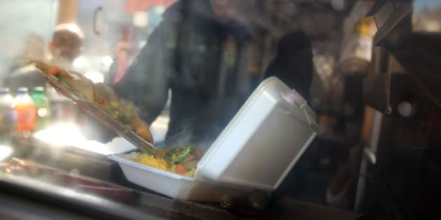 NEW YORK, NY - DECEMBER 19:  A food cart worker fills a styrofoam take-out container with food for a customer on December 19, 2013 in New York City. New York's City Council will vote Thursday on a bill that would see expanded polystyrene (EPS), or styrofoam, either banned or added to the city's curbside recycling program. The current version of the bill would give the city's sanitation commissioner until Jan. 1, 2015 to decide whether plastic foam is recyclable. The proposed ban has been met with resistance from the American Chemistry Council and Dart Container among other groups.  (Photo by Spencer Platt/Getty Images)