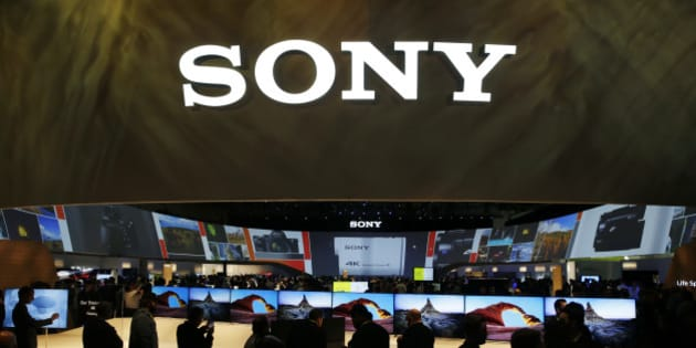 People crowd around the Sony booth during the International CES Tuesday, Jan. 6, 2015, in Las Vegas. The International CES in Las Vegas is the largest trade show in the Americas, with more than 2 million square feet of exhibit space — or about 35 football fields. (AP Photo/John Locher)