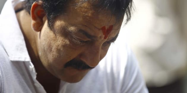 Indian Bollywood actor Sanjay Dutt, looks down during a press conference at his residence in Mumbai, India, Thursday, March 28, 2013. Dutt said he has not sought pardon for a 1993 weapons conviction and will serve his prison sentence as ordered by India's Supreme Court. Dutt broke his silence a week after the court sentenced him to five years in prison for illegal possession of weapons supplied by Mumbai crime bosses linked to a 1993 terror attack that killed 257 people.(AP Photo/Rafiq Maqbool)