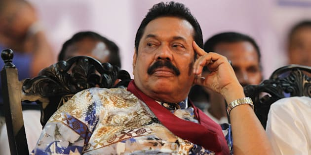 "Sri Lankan President Mahinda Rajapaksa attends his final public rally for the presidential elections in Kesbewa, about 20 kilometers (12 miles) southeast of Colombo, Sri Lanka, Monday, Jan. 5, 2015. A confident Rajapaksa had called the election two years ahead of schedule, hoping to win a third six-year term before voters' memories faded of the defeat of the Tamil Tiger rebels. But an internal revolt now threatens his hold on power with Health Minister Maithripala Sirisena, a close Rajapaksa aide and No. 2 in the president's Freedom Party, defecting and announcing he would run as an opposition candidate in Thursday's election. Poster reads ""Leader of the common."" (AP Photo/Sanka Gayashan)"