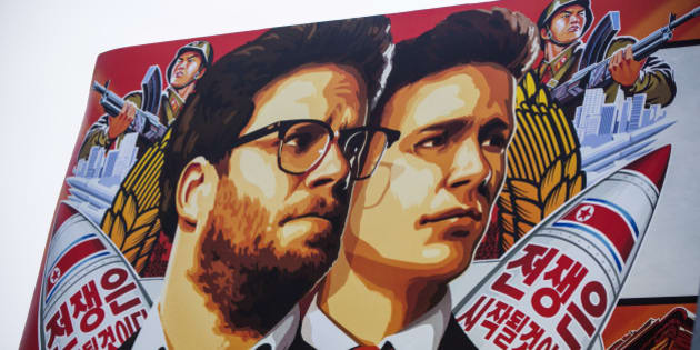 "A banner for ""The Interview""is posted outside Arclight Cinemas, Wednesday, Dec. 17, 2014, in the Hollywood section of Los Angeles. A U.S. official says North Korea perpetrated the unprecedented act of cyberwarfare against Sony Pictures that exposed tens of thousands of sensitive documents and escalated to threats of terrorist attacks that ultimately drove the studio to cancel all release plans for ""The Interview."" (AP Photo/Damian Dovarganes)"