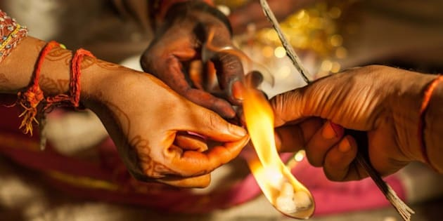 NEW DELHI, INDIA - MARH 13:  The groom incenses which is believed to bring plentifulness, during his wedding ceremony in the outskirts of New Delhi, India on March 13, 2014. Usually around 500 to 1000 guests wearing traditional clothes, attend the traditional wedding ceremony. The ceremony including traditional foods, music and dance, may differ from religion, culture and region. (Photo by Mohamed Hossam/Anadolu Agency/Getty Images)