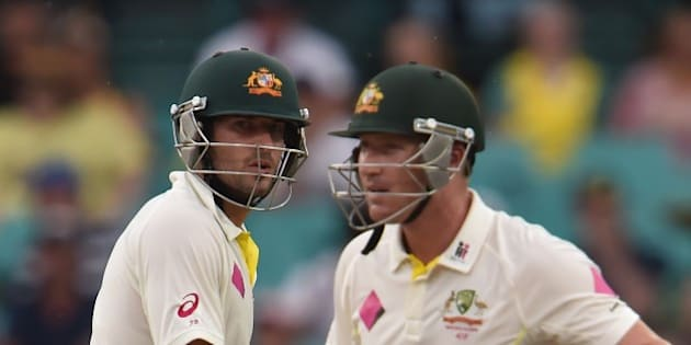 Australian batsman Joe Burns (L) and Brad Haddin (R) talk at the wicket during day four of the fourth cricket Test between Australia and India at the Sydney Cricket Ground (SCG) on January 9, 2015. AFP PHOTO/Peter PARKS --IMAGE RESTRICTED TO EDITORIAL USE - STRICTLY NO COMMERCIAL USE        (Photo credit should read PETER PARKS/AFP/Getty Images)