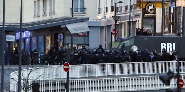 Members of the French special police forces launch the assault at a kosher grocery store in Porte de Vincennes, eastern Paris, on January 9, 2015 where at least two people were shot dead on January 9 during a hostage-taking drama at a Jewish supermarket in eastern Paris, and five people were being held, official sources told AFP. Several hostages were freed after French commandos stormed a Jewish supermarket in eastern Paris where an assailant was holed up on January 9. After several explosions, police stormed the shop in Portes de Vincennes and everal hostages exited the store shortly afterwards and were taken to safety.  AFP PHOTO / THOMAS SAMSON        (Photo credit should read THOMAS SAMSON/AFP/Getty Images)