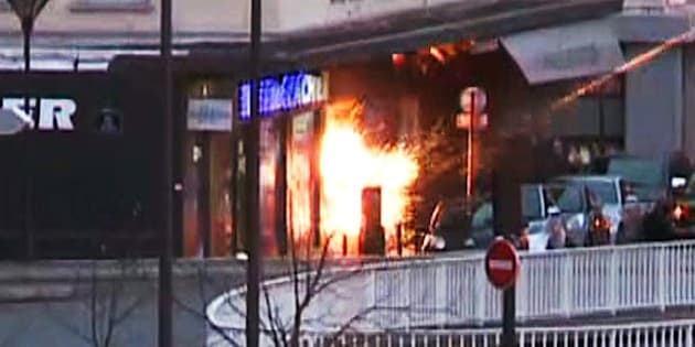 A screengrab taken from an AFP TV video shows a general view of members of the French police special forces launching the assault at a kosher grocery store in Porte de Vincennes, eastern Paris, on January 9, 2015 where at least two people were shot dead on January 9 during a hostage-taking drama at a Jewish supermarket in eastern Paris, and five people were being held, official sources told AFP. Several hostages were freed after French commandos stormed a Jewish supermarket in eastern Paris where an assailant was holed up on January 9. After several explosions, police stormed the shop in Portes de Vincennes and everal hostages exited the store shortly afterwards and were taken to safety. AFP PHOTO / AFPTV / GABRIELLE CHATELAIN        (Photo credit should read GABRIELLE CHATELAIN/AFP/Getty Images)
