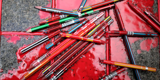Broken pens lay on the ground as members of a leftist party gather outside the French consulate to pay tribute to the victims of the French satirical newspaper Charlie Hebdo, in Istanbul, Turkey, Friday, Jan. 9, 2015. 12 people were killed on Jan. 7 in a terrorist attack at the Charlie Hebdo headquarters in Paris. (AP Photo/Emrah Gurel)
