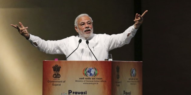 Indian Prime Minister Narendra Modi speaks during the Pravasi Bharatiya Divas (PBD) in Gandhinagar, India, Thursday, Jan. 8, 2015. Pravasi Bharatiya Divas (PBD) is an annual event to mark the contribution of overseas Indian community in the development of India. The three day event began in Gandhinagar on Wednesday. (AP Photo/Ajit Solanki)