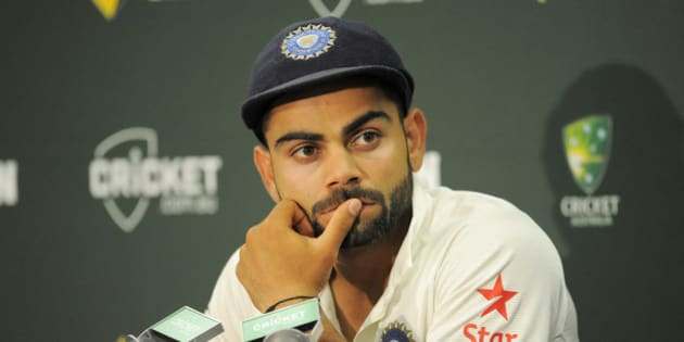 SYDNEY, AUSTRALIA - JANUARY 10:  Virat Kohli of India looks on during day five of the Fourth Test match between Australia and India at Sydney Cricket Ground on January 10, 2015 in Sydney, Australia.  (Photo by Brett Hemmings - CA/Cricket Australia/Getty Images)