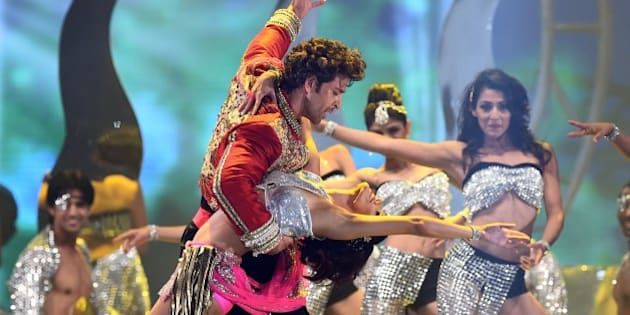 Bollywood actor Hrithik Roshan performs on stage during the fourth and final day of the 15th International Indian Film Academy (IIFA) Awards at the Raymond James Stadium in Tampa, Florida, April 27, 2014. AFP PHOTO/Jewel Samad        (Photo credit should read JEWEL SAMAD/AFP/Getty Images)