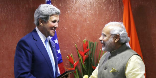 U.S. Secretary of State John Kerry, left, shakes hands with Indian Prime Minister Narendra Modi on the sidelines of the Vibrant Gujarat conference in Ahmedabad, India, Sunday, Jan. 11, 2015. Kerry is in India to attend an international investment conference and push trade ties with the giant South Asian nation ahead of visit by President Barack Obama later this month. (AP Photo/Rick Wilking, Pool)