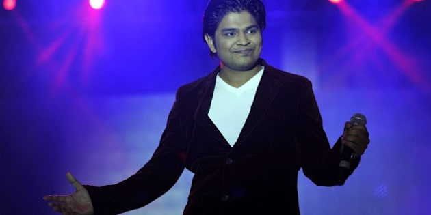 Indian Bollywood playback singer Ankit Tiwari performs during the 'Ticket to Bollywood' fashion show in Mumbai on late July 19, 2014. AFP PHOTO/STR        (Photo credit should read STRDEL/AFP/Getty Images)