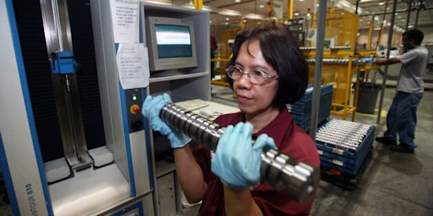 CANADA - MAY 12:  Conchita Villena removes, for measurment and testing, a camshaft for General Motors' GEN4 V8 engines, bound for GM sport utility vehicles, May 12, 2006 at Linamar Corp.'s Camcor Manufacturing plant in Guelph, Ontario, Canada. Linamar Corp., Canada's second-largest auto-parts maker, will spend more than C$1 billion ($900 million) with the help of a government grant to build a research and development center, the Ontario government said today.  (Photo by Norm Betts/Bloomberg via Getty Images)