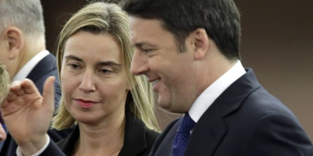 Italian Premier Matteo Renzi, right, is flanked by European Union foreign policy chief, Federica Mogherini, as they wait for Pope Francis to deliver his speech, at the European Council, in Strasbourg eastern France, Tuesday, Nov. 25, 2014. (AP Photo/Andrew Medichini)