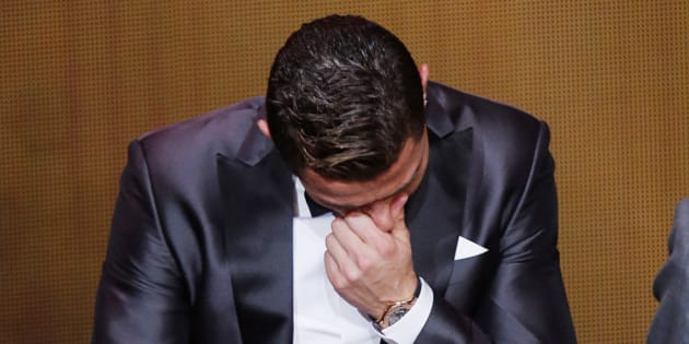 Real Madrid's Christiano Ronaldo of Portugal cries next to his son Ronaldo Junior after receiving the trophy for the world player at the FIFA Ballon d'Or 2013 Gala in Zurich, Switzerland, Monday, Jan. 13, 2014. (AP Photo/Michael Probst)