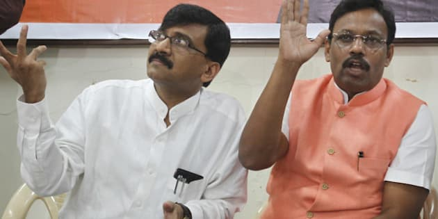 MUMBAI, INDIA - SEPTEMBER 23: (R- L) BJP Leader Vinod Tawde and Shiv Sena spokesman Sanjay Raut addressing press after the BJP-Sena executive committee meeting at Dadar on September 23, 2014 in Mumbai, India.  Both parties said that they were firm on continuing the alliance as they resumed the deadlocked seat-sharing talks for Maharashtra Assembly polls. (Photo by Satish Bate/Hindustan Times via Getty Images)