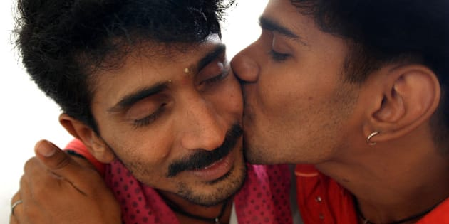 HIV positive Krishna, 21, left, gets kkiss from his partner Srinivasan, 34, also HIV positive, at a counseling centre on HIV/AIDS in Chennai, India, Thursday, Nov. 30, 2006.  Srinivasan and Krishna are homosexual partners and also commercial sex workers for male clients. World Aids Day will be observed on Dec. 1. (AP Photo/ M.Lakshman)** INDIA OUT**